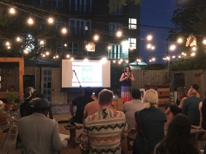 Lisa Huffaker playing the flute during Design Society's PechaKucha night hosted by The Wild Detectives. (Photo by Sara Magalio)