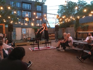 Claire and Grace Cuny perform a duet during the Reliant Tom concert held at the Wild Detectives. (Photo by Sara Magalio)